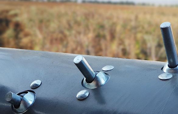 dedos retráctiles de metal en cabezal multicrop